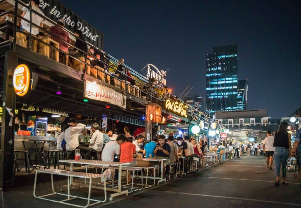 People sitting and eating at Talad Rot Fai | Thailand Event Guide