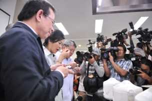 Yingluck tasting cooked Thai Rice