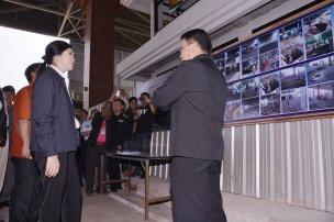 Nong Khai - Yingluck listening to a briefing