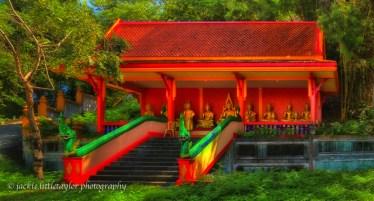 small shrine below Wat Siray green trees sky above