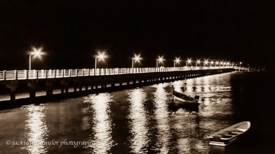 lighted pier at night B/W 16x9