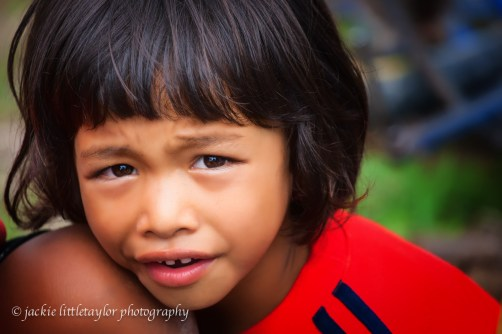 Little Girl Issan Village life Thailand red shirt