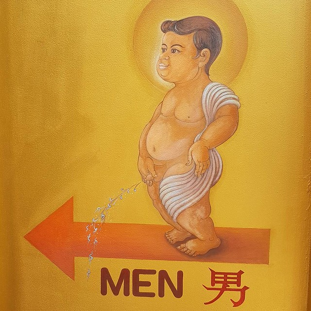 Toilet sign in the White temple in Chiang Rai