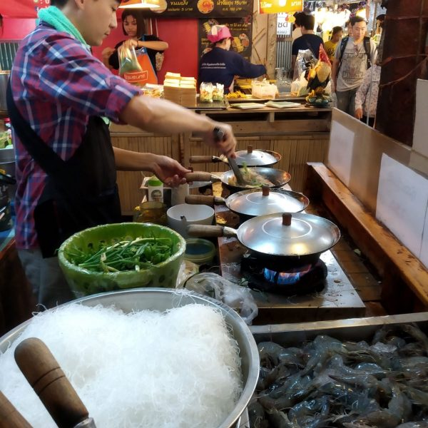 Man preparing food at Lat Mayom floating market, Bangkok