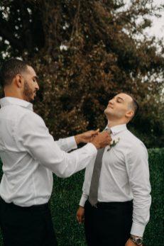 best man helping groom