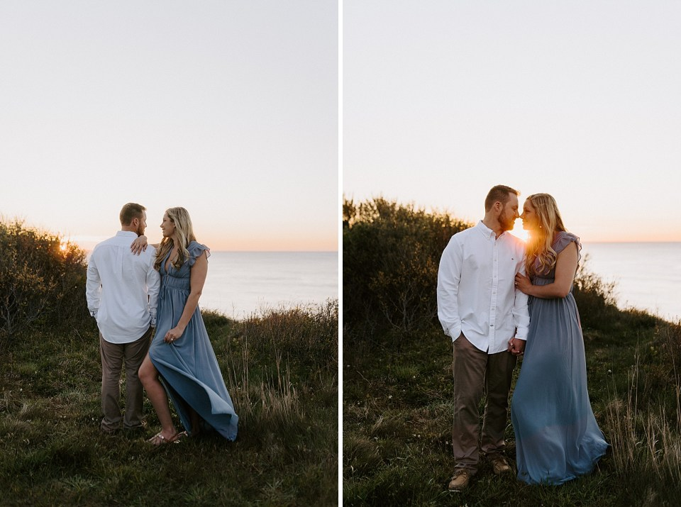Portrait of couple standing in opposite directions with the sun setting on the ocean