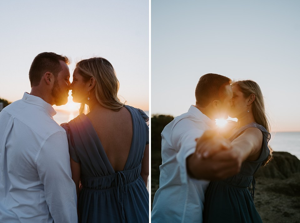 Couple about to kiss with the sunset light shining on them