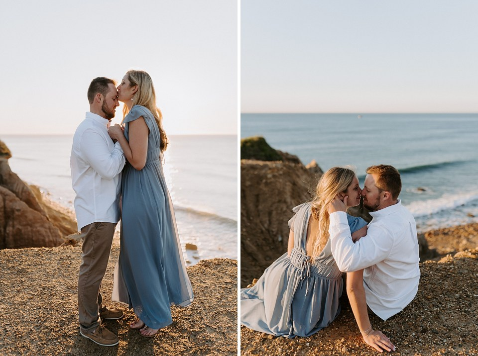 Woman on her tip toes kissing man on the forehead while the sun sets