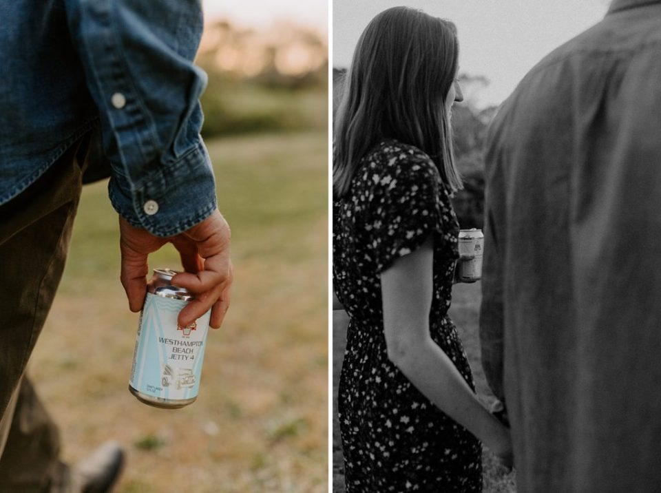 Closeup of couple holding cans of beer in hand