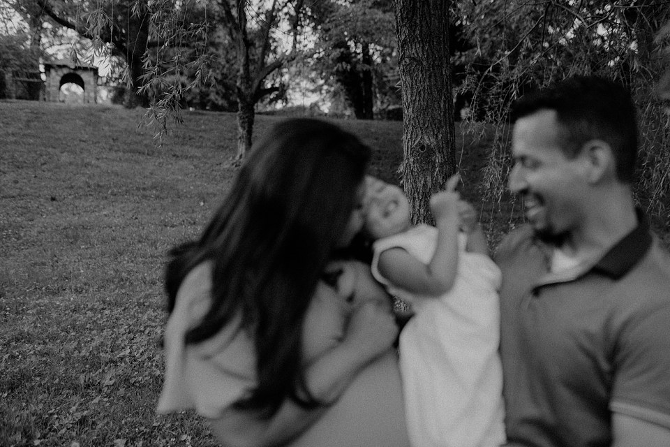 Blurry B&W of Parents holding daughter together