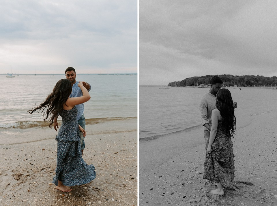 Couple twirling on the sand in front of the ocean