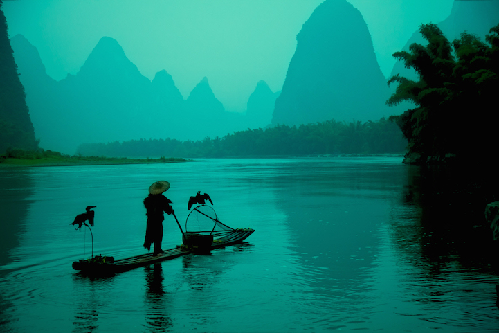 Chinese cormorant fisherman on the Li River in the morning