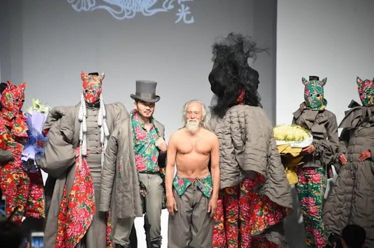 """79-year-old Chinese actor Wang Deshun, topless, displays a new creation by Chinese fashion designer Sheguang Hu at the Sheguang Hu fashion show during the China Fashion Week Fall/Winter 2015 in Beijing, China, 25 March 2015."""