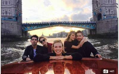 All aboard! Taylor Swift cosies up to Calvin Harris as they enjoy a boat trip on the River Thames