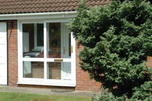 Halo Patio Door in white as a porch front