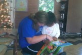 Kiley reading to her friend Maria