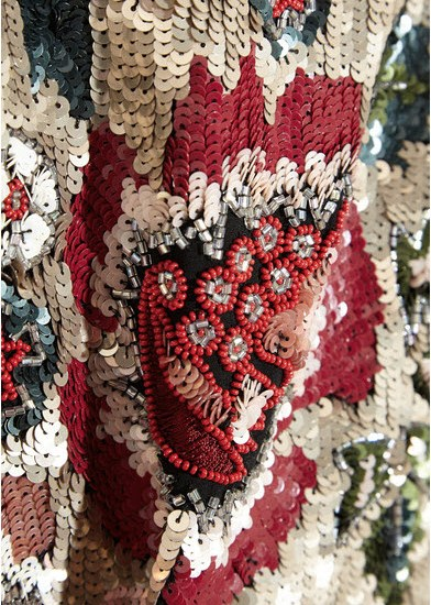 embroidered beads accentuate the bold floral design