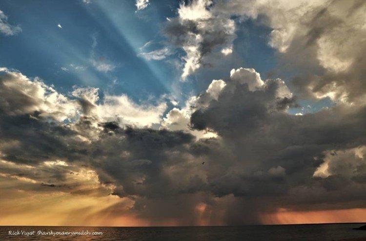 When it rains it pours. Off shore Pere Marquette Beach June 9, 2021
