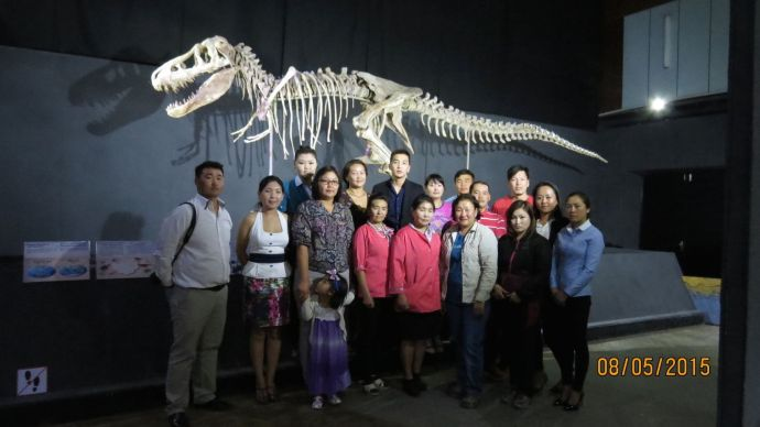 Bolor's colleagues in Mongolia pose with the Torbosaurus bataar specimen that was recently returned to its county. Photo courtesy of Bolor Minjin.