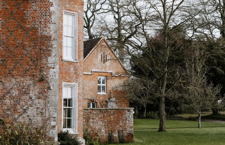 limewash brick house | That 1 Painter