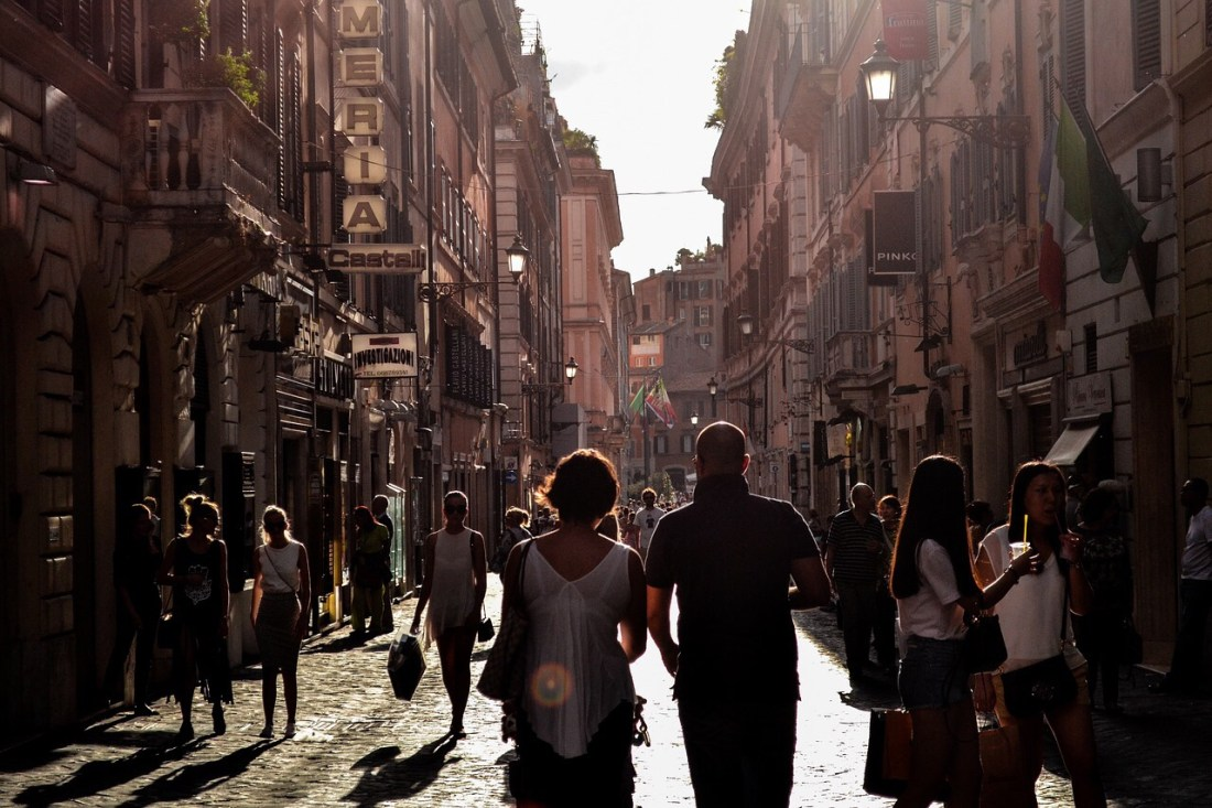 People walking down a street in Naples, Italy