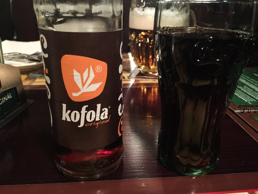 Bottle and glass of Kofola in Prague