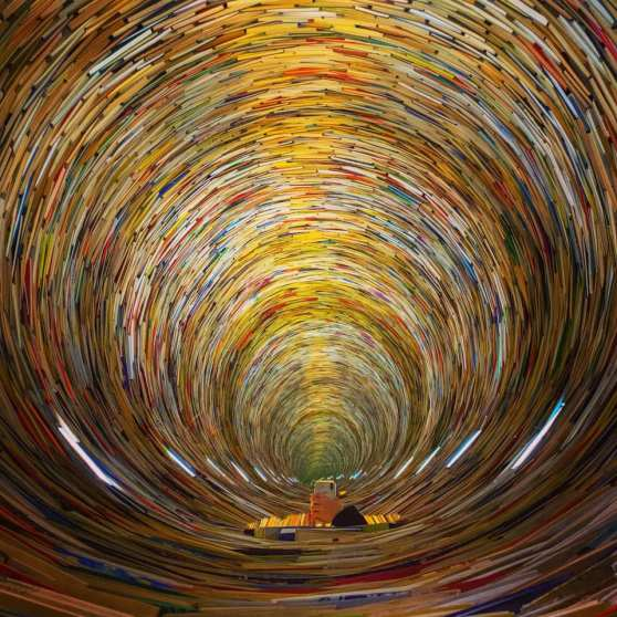 Photo of the book tower in Prague library, a tunnel made of books