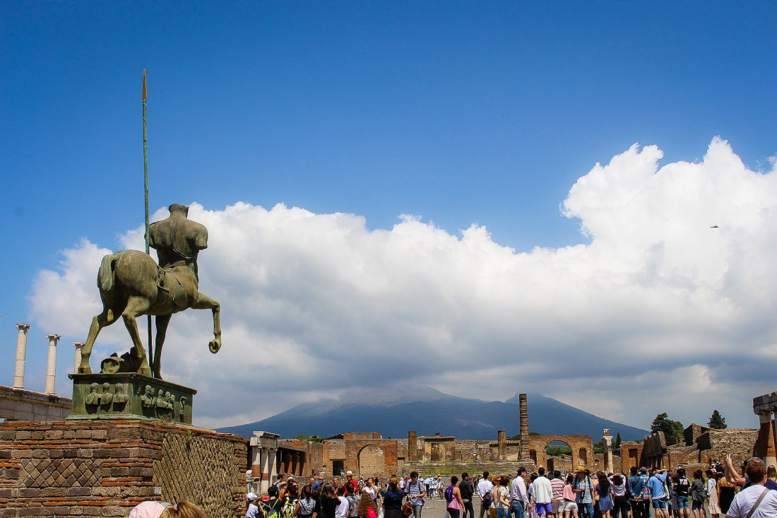 Pompeii, with a statue looking towards Mount Vesuvius