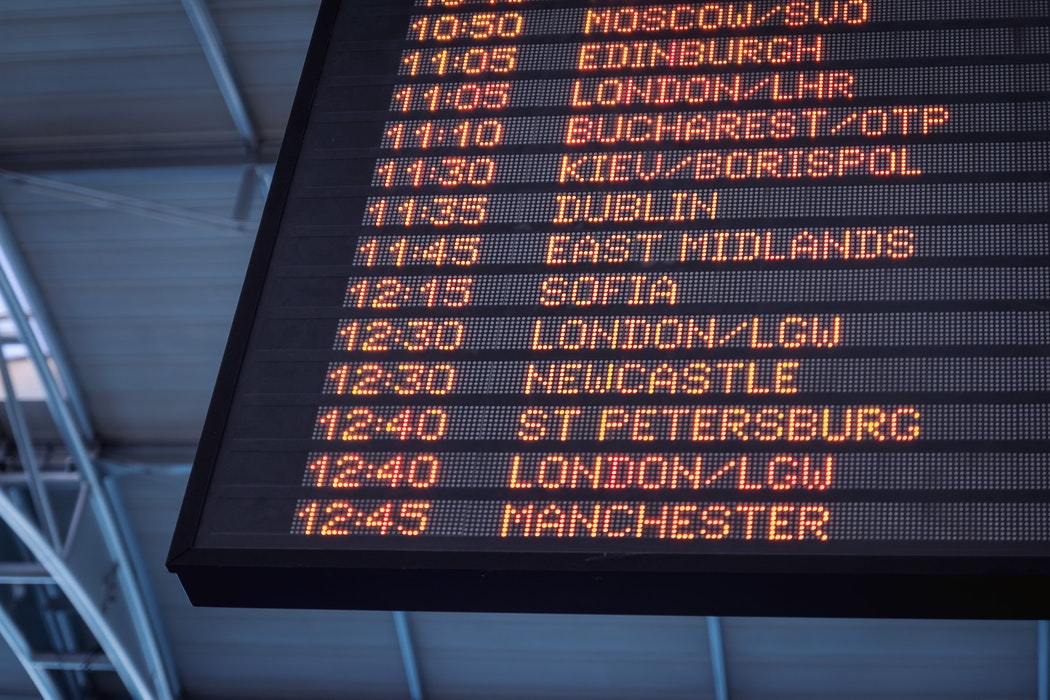 A departures board list various flights