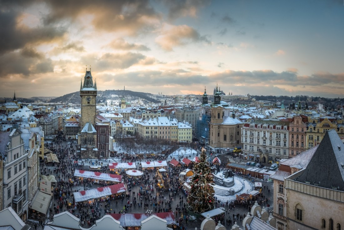 Snowy sky above a Christmas market in Prague