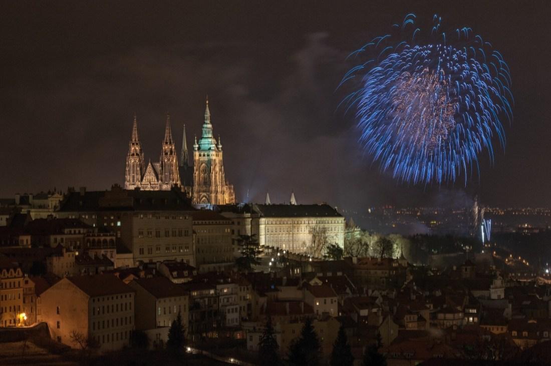 A firework explodes near Prague Castle