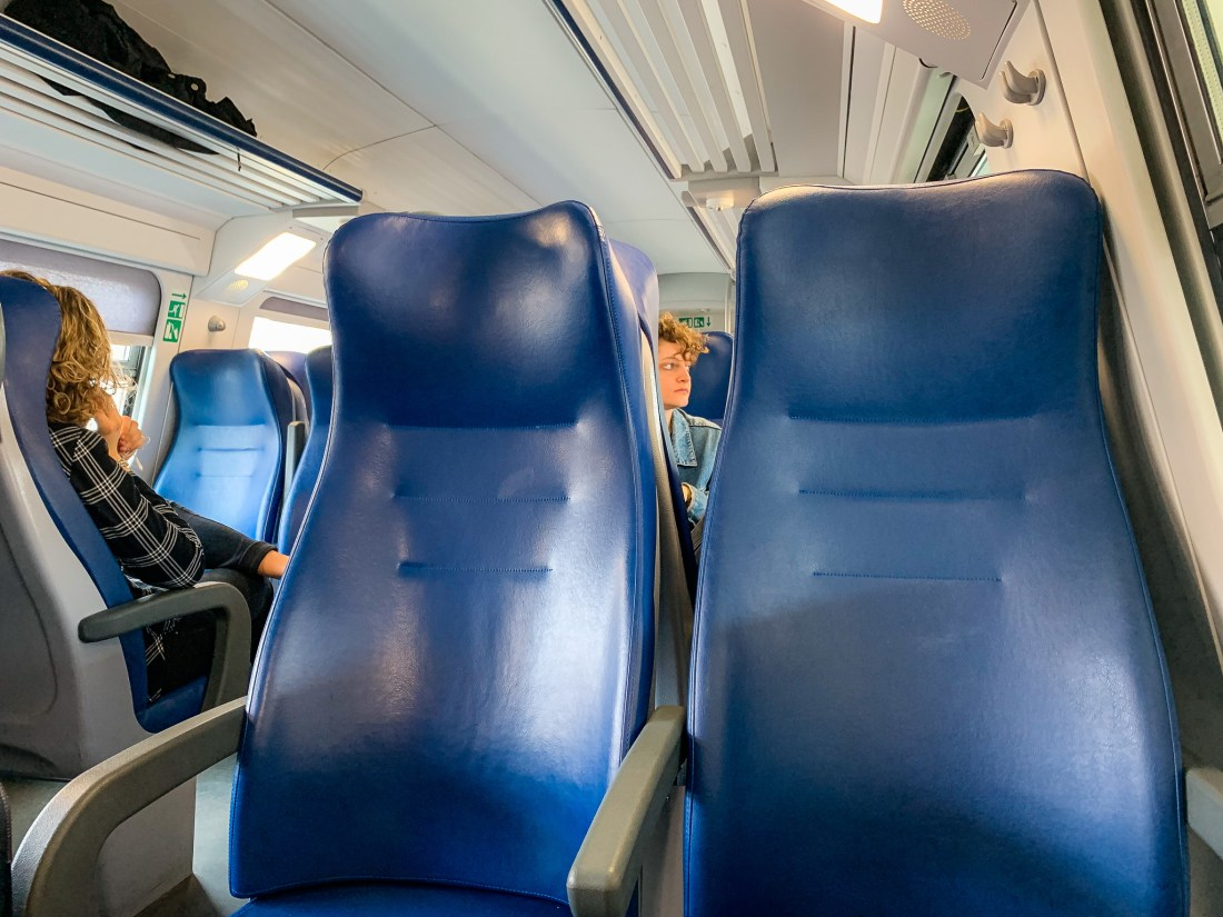 The blue seats of an Italian train
