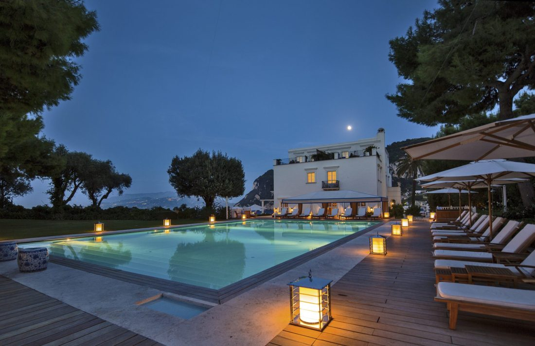 The pool of the J.K. Place Capri hotel at twilight. This is a great base for exploring the many things to do in Capri