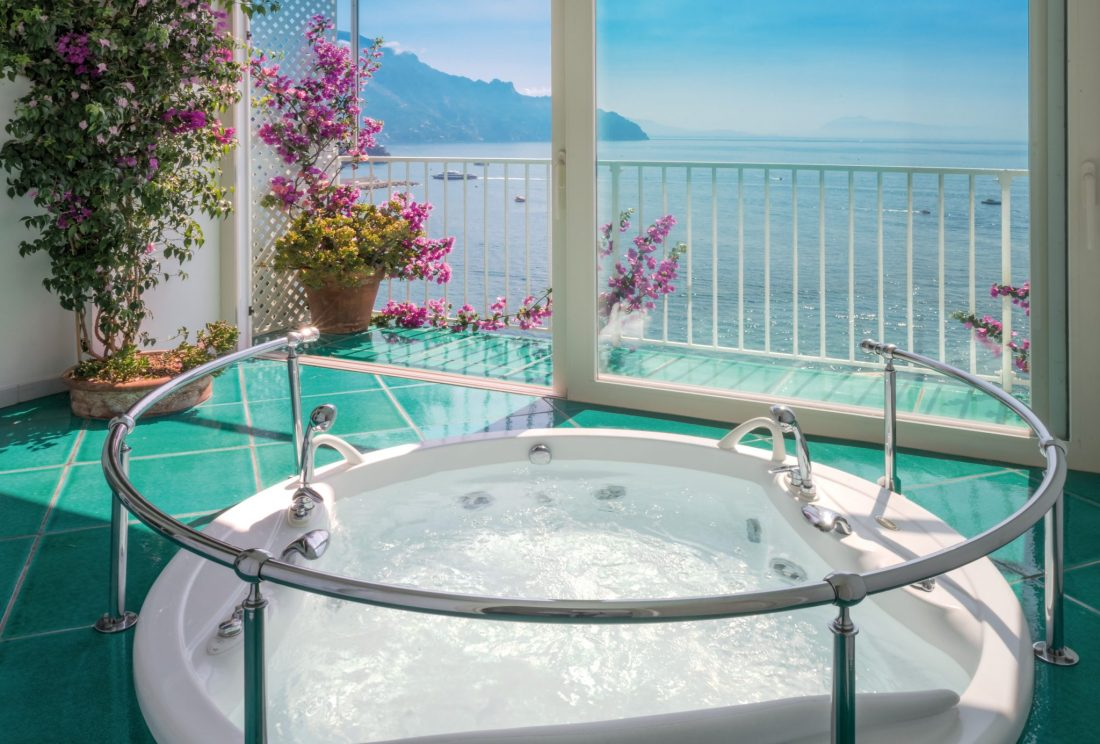 A hot tub near a view of the sea at Santa Caterina hotel - The best hotels on the Amalfi Coast for all budgets