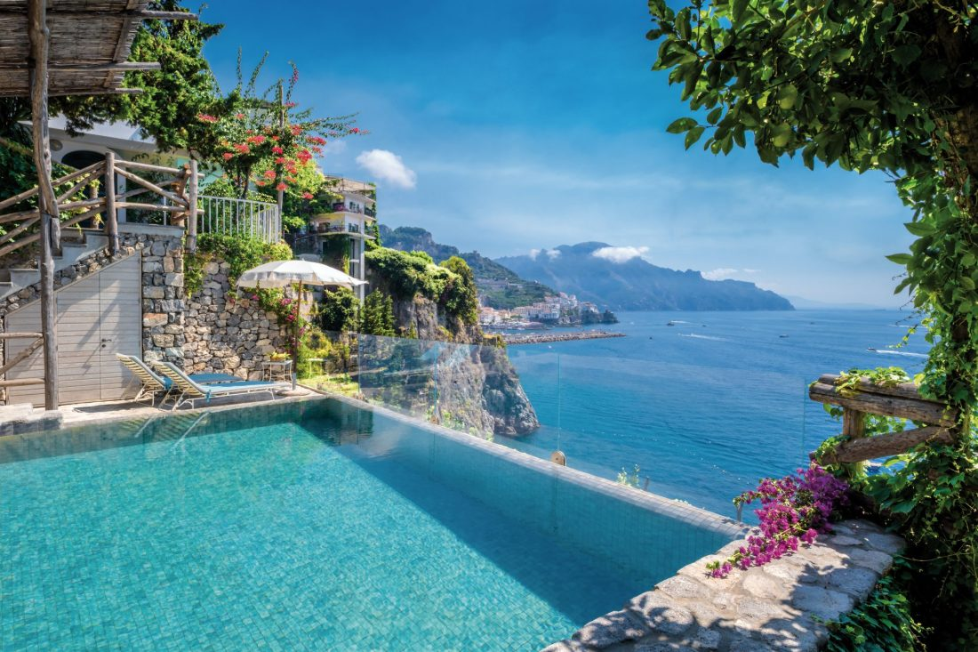 An infinity pool overlooks a brilliant blue sea - The best hotels on the Amalfi Coast for all budgets
