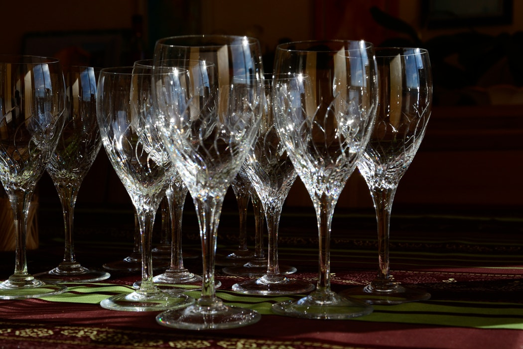 Crystal glasses set together on a wooden surface