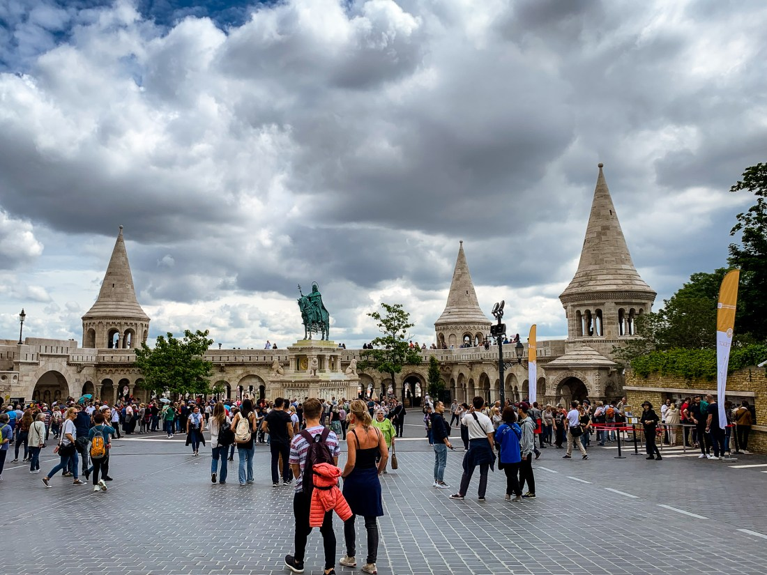 A large crowd of people in front of Fisherman's Bastion, Budapest
