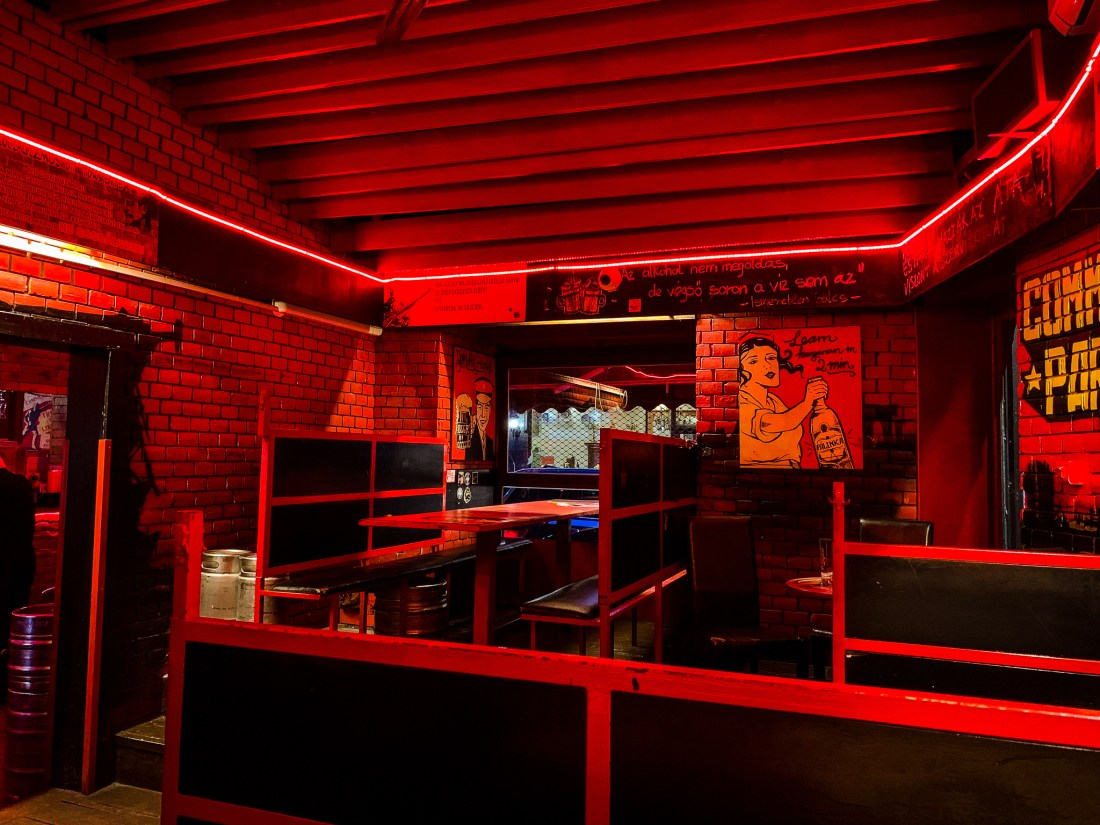 A ruin pub, decorated in red with a Communist theme. Ruin pubs are the best known element of Budapest nightlife.