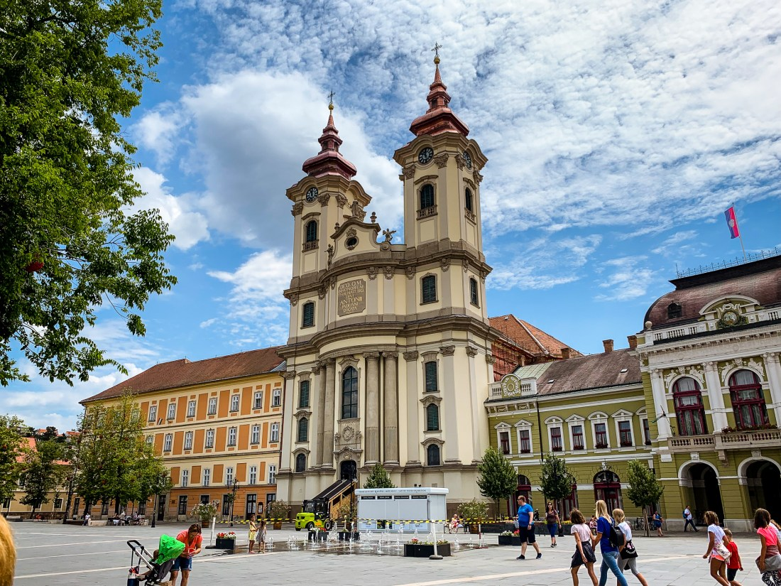 Eger's beautiful city hall, with two towers and a public square in front. Eger is a simple day trip from Budapest, and easy to reach if you have 3 days in Budapest.