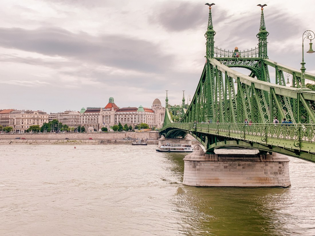 The green metal of the Liberty Bridge, topped with two metal birds. This bridge links Buda to Pest, and is one of Budapest's highlights.
