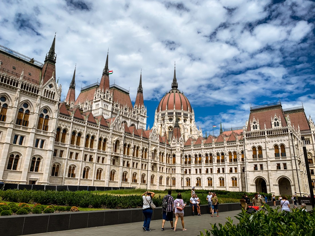 The Hungarian Parliament building, a must for anyone with 3 days in Budapest. A dome stands above a building with many windows.