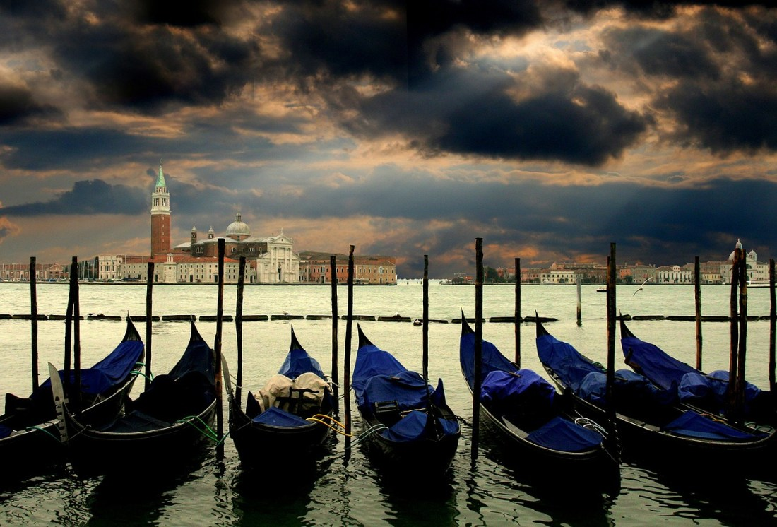 A line of gondolas moored in Venice. Many quotes about Italy convey the city's fabled beauty.
