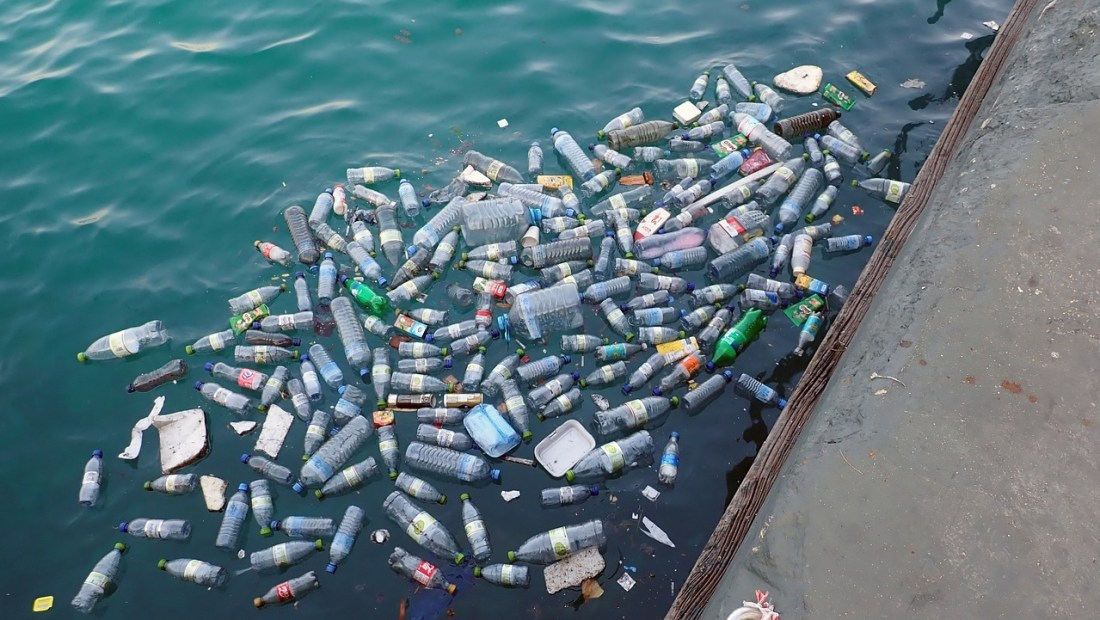 Plastic waste floating in the sea in a port