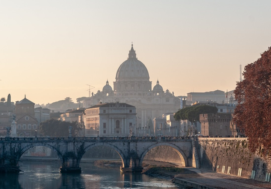 The dome of St. Peter's Basilica in Rome with a bridge in the foreground