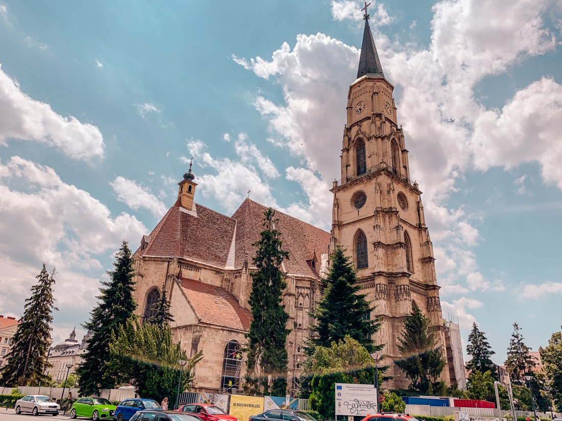 The outside of the historic St. Michael's Church in Piata Unirii Square in Cluj. When deciding what to do in Cluj, this should definitely be on your list.