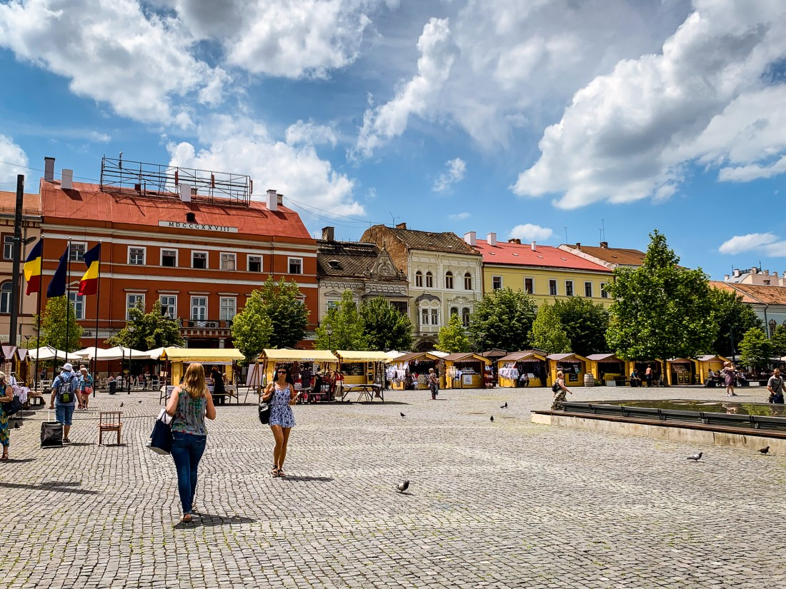 The market in Piata Unirii Square is near many good places where to stay in Cluj