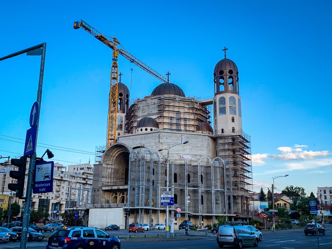 The vast cathedral under construction in Cluj-Napoca is well worth seeing. Large cranes help to build it.
