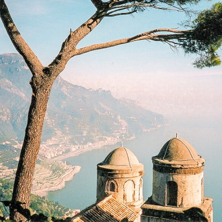 Definitely one of the most instagrammable spots on the Amalfi Coast, Ravello's Villa Rufolo combines two cupolas, a tree, and the blue sea and sky beyond.