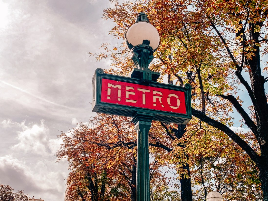 A metal sign showing the entrance of the Metro; a Paris landmarks in itself!