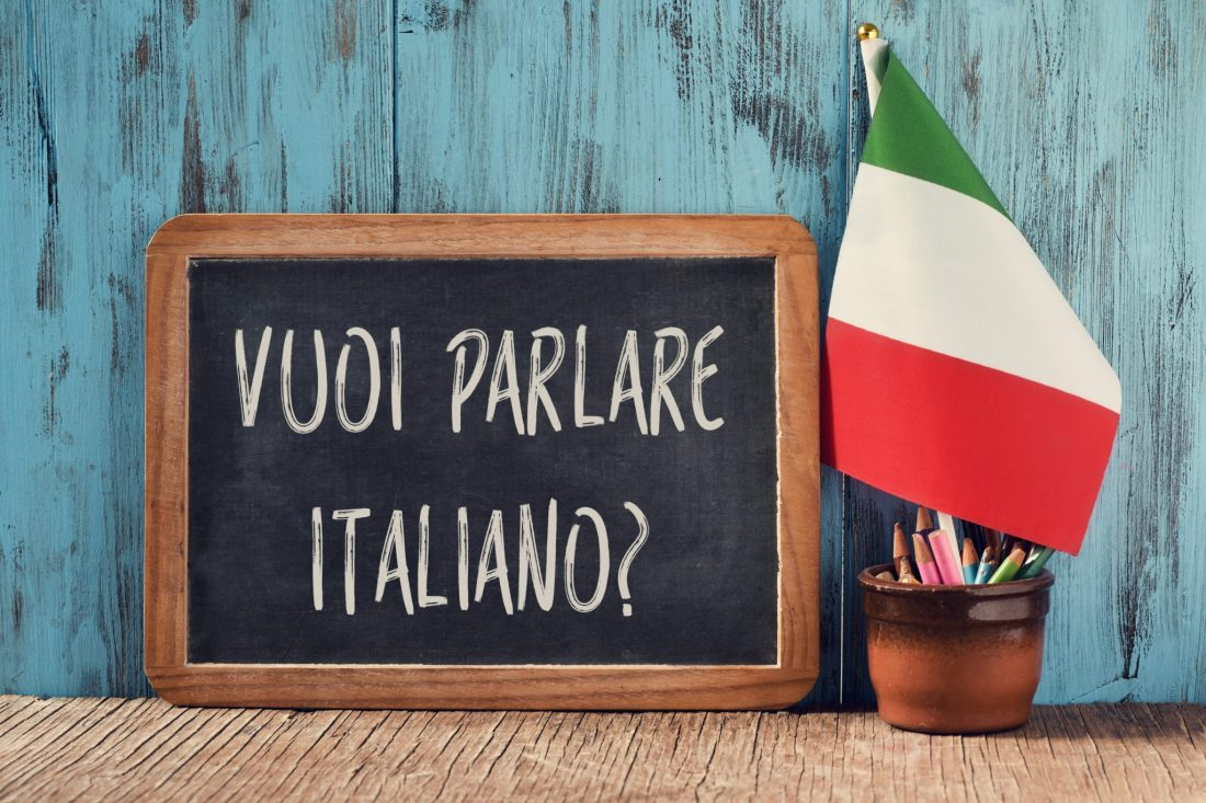 "Although not one of the crucial do's and dont's in Italy, learning the language is polite. Here a chalkboard says ""do you want to speak Italian?"" with a flag."